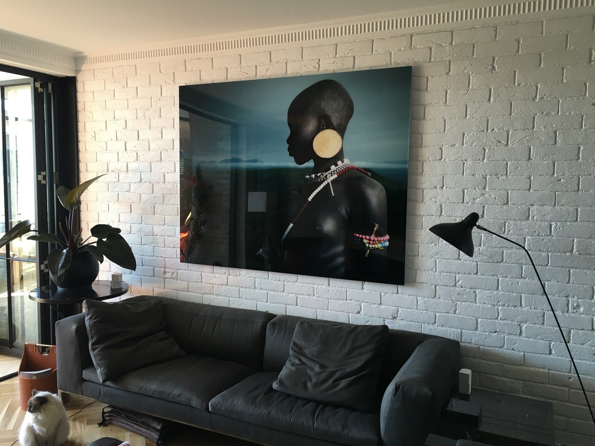 Large art on perspex floating frame installation on rough brick wall, Art Hanging Systems, picture hanging, picture systems, picture hanging tracks, picture hanging wire, picture hanging services, picture hanging wire, hooks, cables, track walls